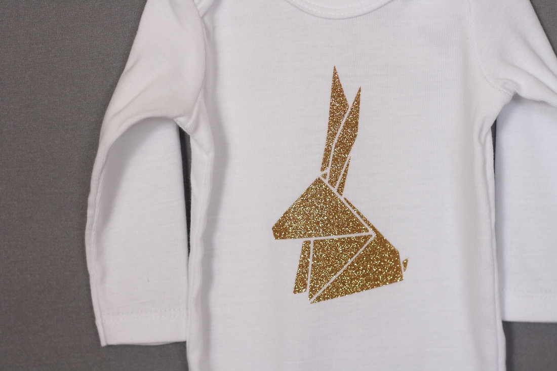 Glitter onesie with origami animal