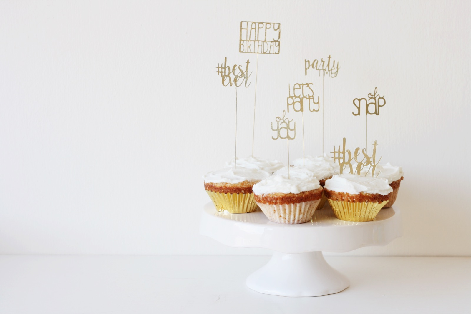 Gold lettered cupcake toppers