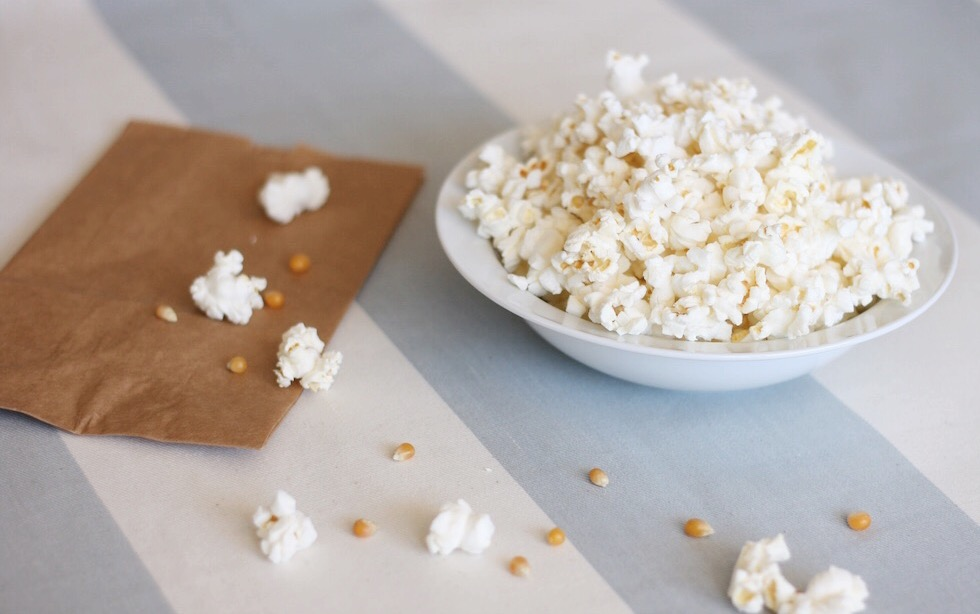 Homemade popcorn with a brown paper bag