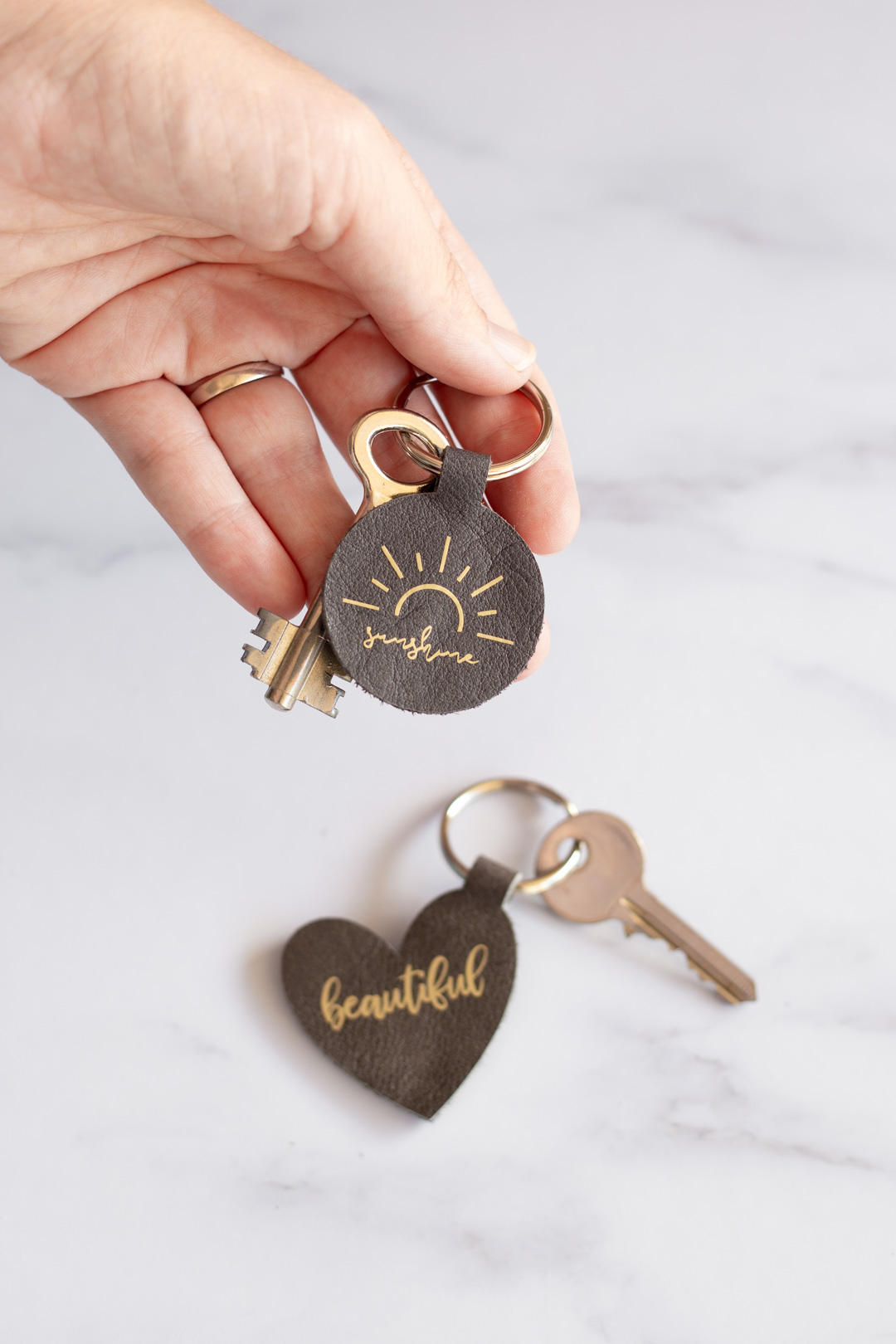 Leather Keyrings made with Cricut Maker and iron-on heat transfer vinyl. Easy deign including free SVG, PNG and project link